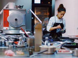 chef preparing food safely in restaurant