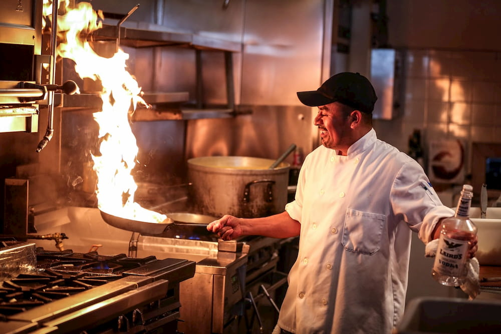 chef with flaming pan types of chefs