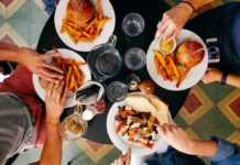dining on cheeseburgers western and eastern eating habits